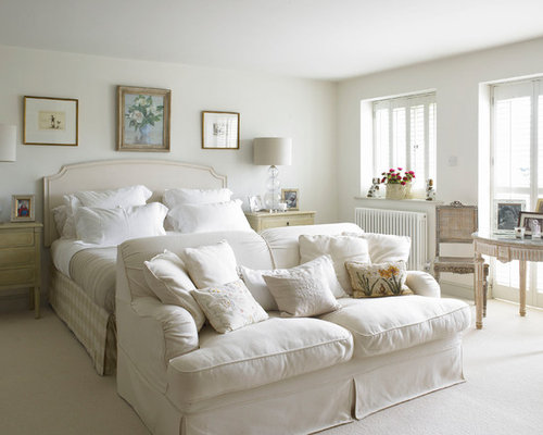 Large Farmhouse Master Carpeted Bedroom Idea In Wiltshire With White Walls