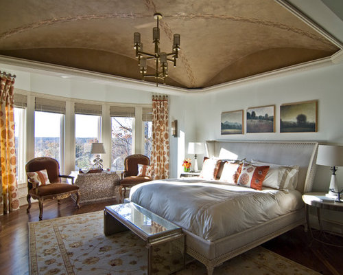 example of an eclectic bedroom design in charlotte with white walls and medium tone hardwood floors - Beautiful Bedrooms
