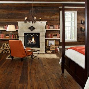 Неиссякаемый источник вдохновения для домашнего уюта: хозяйская спальня в стиле современная классика с темным паркетным полом, коричневыми стенами, стандартным камином и фасадом камина из бетона