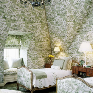 This is an example of a victorian guest bedroom in San Francisco with multi-coloured walls, carpet and green floor.