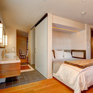 Inspiration for a mid-sized contemporary master medium tone wood floor and brown floor bedroom remodel in Denver with white walls and no fireplace