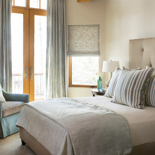 Example of a transitional bedroom design in Denver with white walls