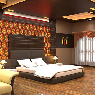 Inspiration for a large modern master bedroom in Other with brown walls, vinyl floors and brown floor.