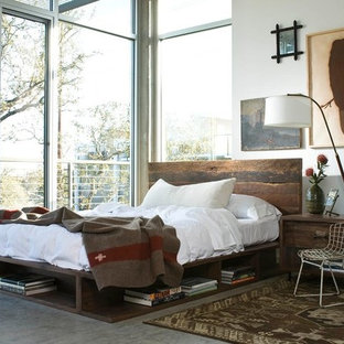 Bedroom - rustic concrete floor and gray floor bedroom idea in Houston with white walls