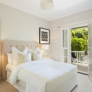 Photo Of A Transitional Guest Bedroom In Sydney With Grey Walls And Carpet