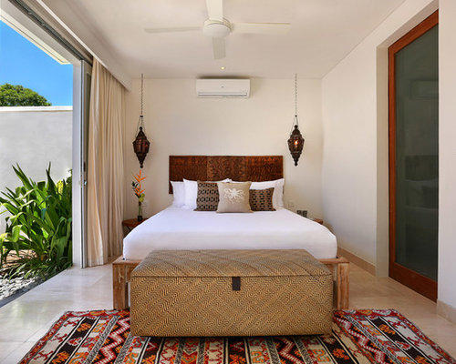 This Is An Example Of A Mid Sized Tropical Master Bedroom In Other With No