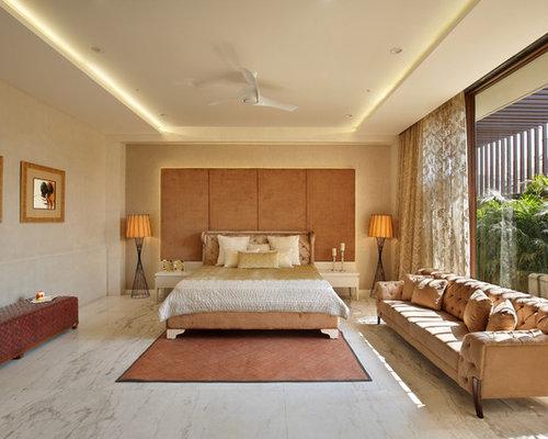 bedroom mediterranean master marble floor and beige floor bedroom idea in ahmedabad with beige walls
