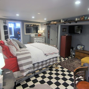 Example of a large eclectic master linoleum floor bedroom design in Baltimore with gray walls and no fireplace