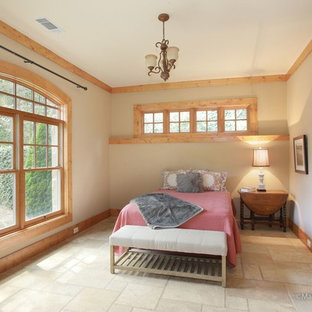 This is an example of a mid-sized arts and crafts bedroom in Atlanta with beige walls, ceramic floors and no fireplace.