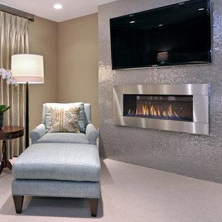 На фото: спальня в стиле современная классика с горизонтальным камином и фасадом камина из металла с