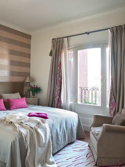 Inspiration For A Mid Sized Transitional Medium Tone Wood Floor Bedroom Remodel In Barcelona With