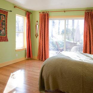 Bedroom - mid-sized eclectic master bamboo floor bedroom idea in Sacramento with green walls