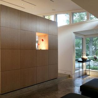 Example of a minimalist concrete floor bedroom design in Dallas