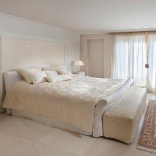 Elegant marble floor bedroom photo in Other with beige walls