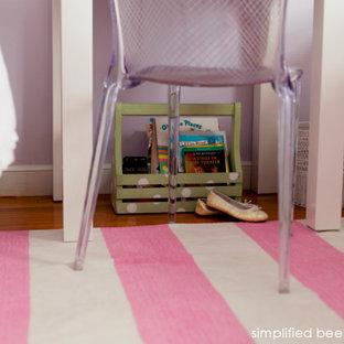 Example of an eclectic light wood floor bedroom design in San Francisco with purple walls