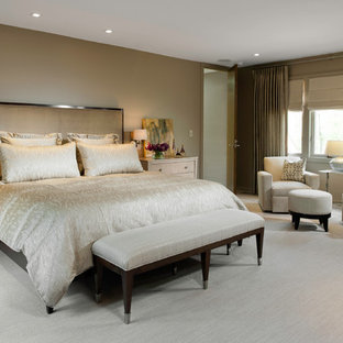 Large trendy master carpeted and beige floor bedroom photo in Chicago with brown walls and no fireplace