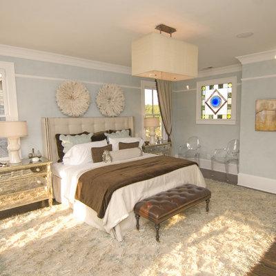 Inspiration for a contemporary medium tone wood floor bedroom remodel in Atlanta with blue walls