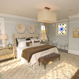 Inspiration for a contemporary medium tone wood floor bedroom remodel in Atlanta with blue walls