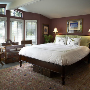 This is an example of a traditional master bedroom in San Francisco with no fireplace, slate floors and brown walls.