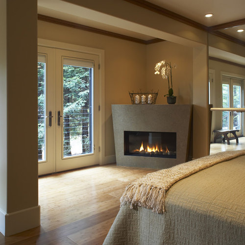 Example Of A Trendy Bedroom Design In San Francisco With A Corner Fireplace