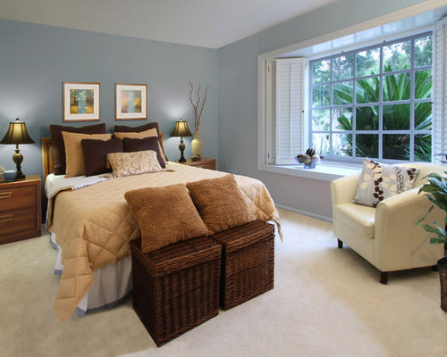 Example Of A Trendy Carpeted Bedroom Design In San Diego With Blue Walls