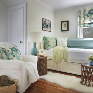 Example of a coastal guest medium tone wood floor bedroom design in Providence with green walls