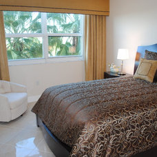 Tropical Bedroom by Kathryn Interiors, Inc.