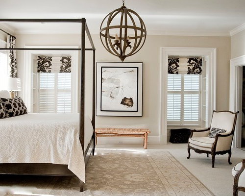Example Of A Classic Master Carpeted Bedroom Design In Orlando With Beige Walls