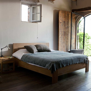 Example of a mountain style bedroom design in London