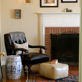 Design ideas for a rustic bedroom in Los Angeles with a brick fireplace surround and a standard fireplace.