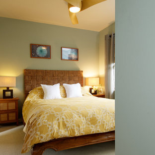 Example of an island style bedroom design in Los Angeles with green walls