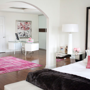 Example of a trendy master medium tone wood floor bedroom design in Toronto with white walls and no fireplace