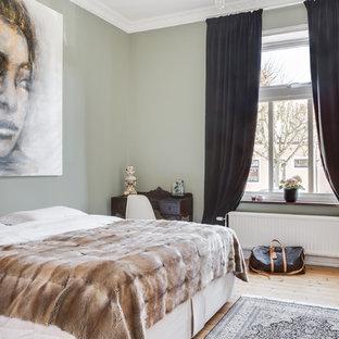 Inspiration For A Medium Sized Scandinavian Master Bedroom In London With Light Hardwood Flooring Green