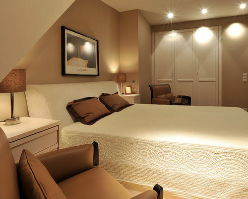 Example Of A Classic Bedroom Design In Other With Beige Walls