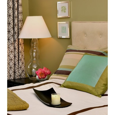 Example of a trendy bedroom design in Boston with green walls and no fireplace