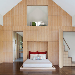 Inspiration for a contemporary guest dark wood floor bedroom remodel in San Francisco with white walls