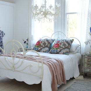 Mid Sized Cottage Chic Light Wood Floor Bedroom Photo In London With White Walls