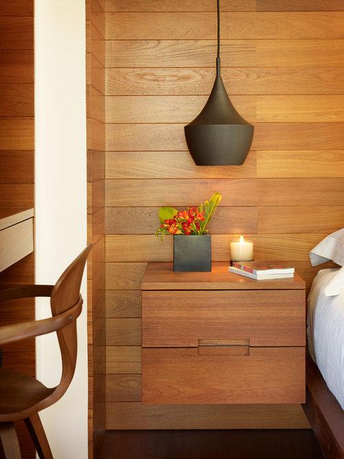 Mid Sized Tropical Master Dark Wood Floor And Brown Floor Bedroom Idea In  Los Angeles