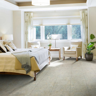 Example of a large classic master ceramic tile and gray floor bedroom design in Jackson with no fireplace and white walls