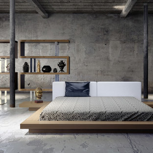 Expansive modern loft-style bedroom in Los Angeles with grey walls, concrete floors and a standard fireplace.