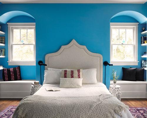Mediterranean Master Bedroom Idea In Nashville With Blue Walls, Medium Tone  Hardwood Floors And Brown