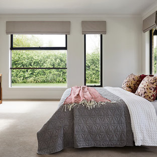 Design ideas for a contemporary guest bedroom in Melbourne with white walls, carpet and white floor.