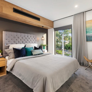 Photo of a contemporary master bedroom in Melbourne with white walls, carpet and grey floor.