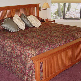 Mid-sized arts and crafts master bedroom in Other with beige walls, carpet and purple floor.