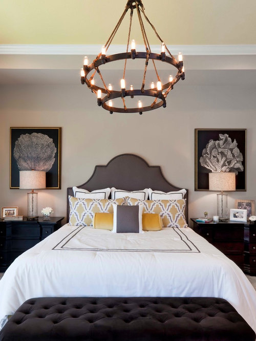 Inspiration for a transitional bedroom remodel in Miami with gray walls. Bedroom Furniture Placement   Houzz
