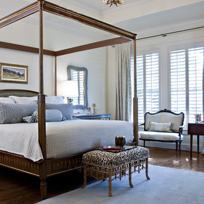 Example of a mid-sized classic master dark wood floor bedroom design in Dallas with white walls
