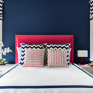 Trendy bedroom photo in New York with blue walls