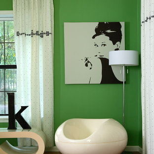 Design ideas for a large eclectic guest bedroom in Atlanta with green walls, terra-cotta floors and no fireplace.