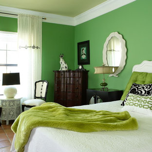This is an example of a large eclectic guest bedroom in Atlanta with green walls, terra-cotta floors and no fireplace.