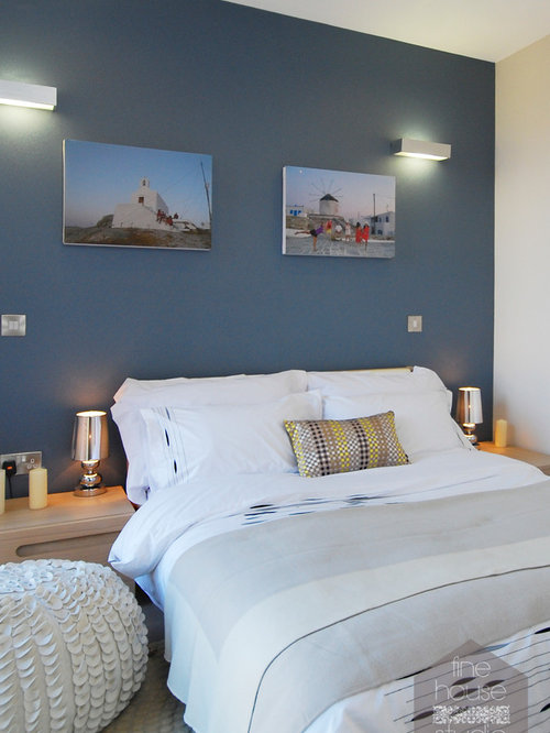 Photo Of A Medium Sized Coastal Guest Bedroom In Gloucestershire With Blue Walls And Carpet